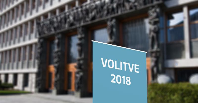 Napis Volitve 2018 pred stavbo državnega zbora